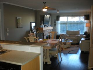 "Photo 5: 104 500 KLAHANIE Drive in Port Moody: Port Moody Centre Condo for sale in ""TIDES"" : MLS®# V939597"