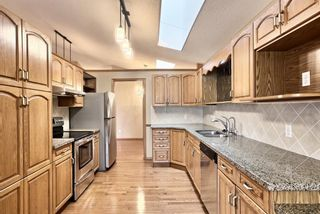 Photo 6: 83 Edgepark Villas NW in Calgary: Edgemont Row/Townhouse for sale : MLS®# A1130715