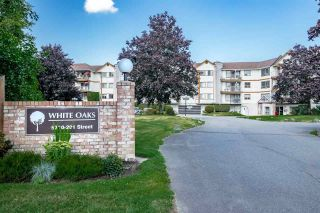 """Photo 1: 310 5710 201 Street in Langley: Langley City Condo for sale in """"White Oaks"""" : MLS®# R2453667"""