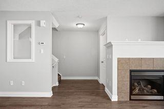 Photo 11: 5 Cougar Ridge Mews SW in Calgary: Cougar Ridge Row/Townhouse for sale : MLS®# A1105171