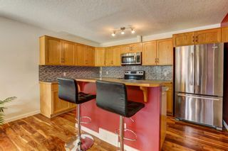 Photo 8: 1 6204 Bowness Road NW in Calgary: Bowness Row/Townhouse for sale : MLS®# A1077280