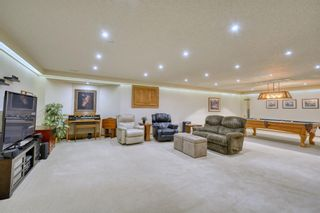 Photo 40: 20A Woodmeadow Close SW in Calgary: Woodlands Row/Townhouse for sale : MLS®# A1127050