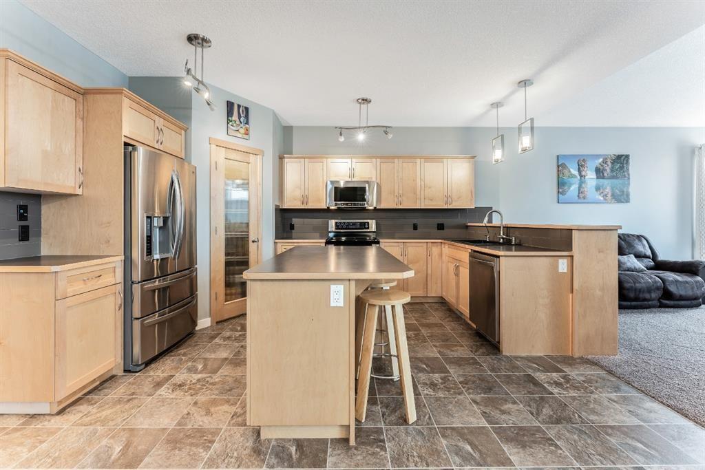 Photo 11: Photos: 434 Boulder Creek Drive SE: Langdon Detached for sale : MLS®# A1066594