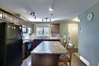 Photo 9: 161 Rainbow Falls Manor: Chestermere Row/Townhouse for sale : MLS®# A1083984