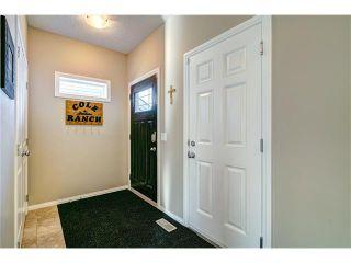 Photo 2: 109 HEARTLAND Way: Cochrane House for sale : MLS®# C4044449
