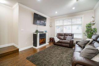 "Photo 2: 5 12036 66 Avenue in Surrey: West Newton Townhouse for sale in ""Dub Villa"" : MLS®# R2565738"