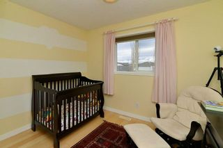Photo 17: 36 EVERSYDE Manor SW in Calgary: Evergreen House for sale : MLS®# C4143440