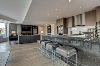 Photo 4: 501 128 Waterfront Court SW in Calgary: Chinatown Apartment for sale : MLS®# A1107113