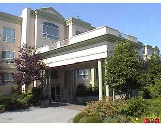 """Photo 1: 13860 70TH Ave in Surrey: East Newton Condo for sale in """"Chelsea Gardens"""" : MLS®# F2625815"""
