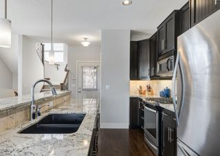 Photo 8: 106 1312 Russell Road NE in Calgary: Renfrew Row/Townhouse for sale : MLS®# A1080835