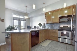 Photo 4: 6401 14 HEMLOCK Crescent SW in Calgary: Spruce Cliff Apartment for sale : MLS®# A1036904