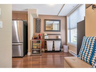 """Photo 5: 220 2110 ROWLAND Street in Port Coquitlam: Central Pt Coquitlam Townhouse for sale in """"AVIVA ON THE PARK"""" : MLS®# R2598714"""
