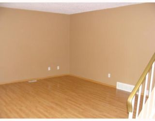 Photo 3: 212 ABADAN Place NE in CALGARY: Abbeydale Residential Detached Single Family for sale (Calgary)  : MLS®# C3389732