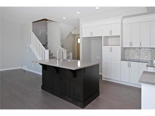 Photo 13: 158 WALGROVE Drive SE in Calgary: Walden House for sale : MLS®# C4075055