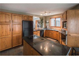 Photo 9: 5947 COACH HILL Road SW in Calgary: Coach Hill House for sale : MLS®# C4056970