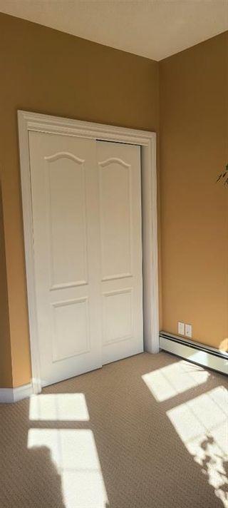 Photo 23: 106 248 Sunterra Ridge Place: Cochrane Apartment for sale : MLS®# A1097518