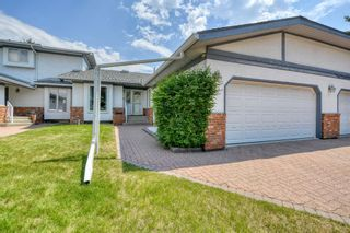 Photo 4: 20A Woodmeadow Close SW in Calgary: Woodlands Row/Townhouse for sale : MLS®# A1127050