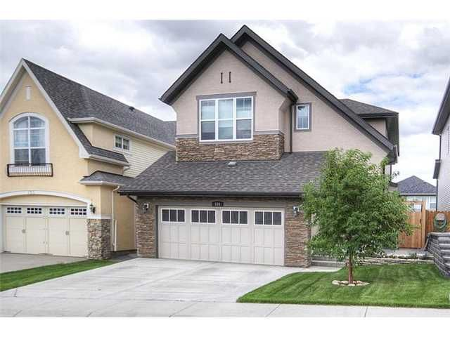 Beautiful curb appeal with steep roof lines and stucco/stone front elevation.