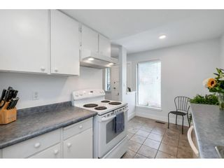 """Photo 15: 15843 ALDER Place in Surrey: King George Corridor Townhouse for sale in """"ALDERWOOD"""" (South Surrey White Rock)  : MLS®# R2607758"""