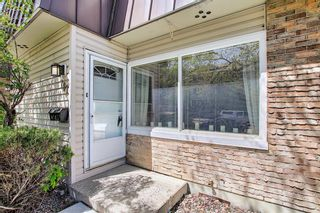 Photo 2: 787 Kingsmere Crescent SW in Calgary: Kingsland Row/Townhouse for sale : MLS®# A1108605