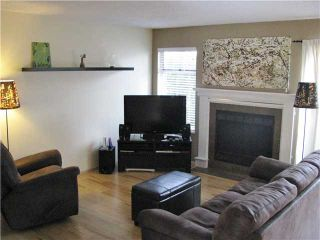 """Photo 2: 104 1180 FALCON Drive in Coquitlam: Eagle Ridge CQ Townhouse for sale in """"FALCON HEIGHTS"""" : MLS®# V1019475"""