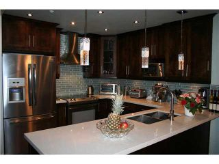 """Photo 6: 105 3600 WINDCREST Drive in North Vancouver: Roche Point Townhouse for sale in """"RAVEN WOODS"""" : MLS®# V1101013"""