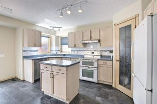 Photo 8: 219 HOLLINGER Close NW in Edmonton: Zone 35 House for sale : MLS®# E4243524