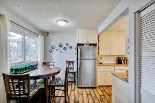 Photo 4: 14 14736 Deerfield Drive in Calgary: Deer Run Row/Townhouse for sale : MLS®# A1092282