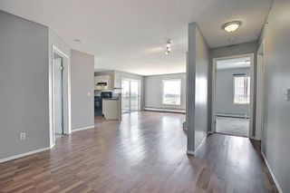 Photo 21: 6413 304 Mackenzie Way SW: Airdrie Apartment for sale : MLS®# A1128019