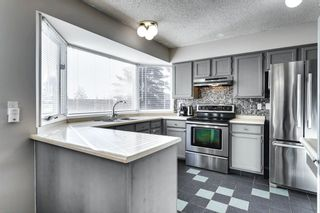 Photo 4: 31 Stradwick Place SW in Calgary: Strathcona Park Semi Detached for sale : MLS®# A1091744