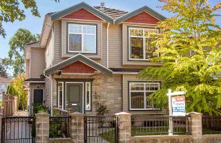 """Photo 1: 450 E 44TH Avenue in Vancouver: Fraser VE 1/2 Duplex for sale in """"Main/Fraser"""" (Vancouver East)  : MLS®# R2108825"""
