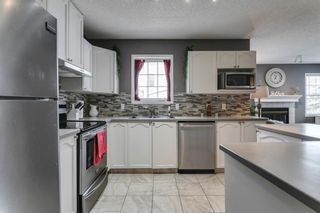 Photo 10: 1905 7171 COACH HILL Road SW in Calgary: Coach Hill Row/Townhouse for sale : MLS®# A1111553