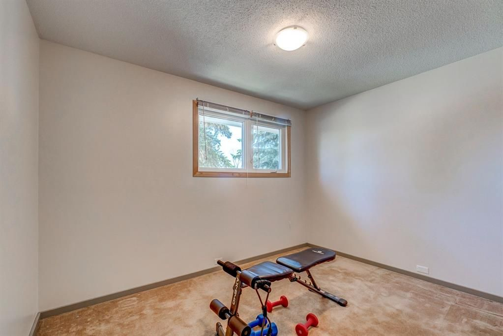 Photo 15: Photos: 499 Canterbury Drive SW in Calgary: Canyon Meadows Detached for sale : MLS®# A1107365