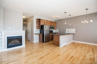 Photo 7: 8 Everridge Gardens SW in Calgary: Evergreen Row/Townhouse for sale : MLS®# A1041120