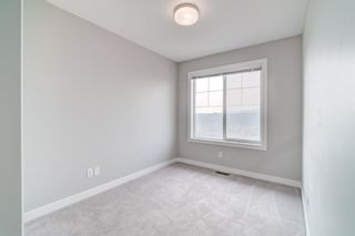 Photo 26: 907 Jumping Pound Common: Cochrane Row/Townhouse for sale : MLS®# A1132952