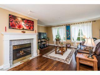 "Photo 3: 228 13880 70 Avenue in Surrey: East Newton Condo for sale in ""Chelsea Gardens"" : MLS®# R2563447"