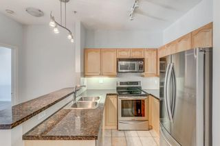 Photo 10: 400 881 15 Avenue SW in Calgary: Beltline Apartment for sale : MLS®# A1146695