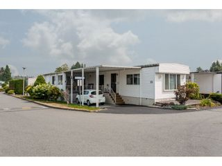 "Photo 1: 25 15875 20 Avenue in Surrey: King George Corridor Manufactured Home for sale in ""Searidge Bays"" (South Surrey White Rock)  : MLS®# R2195866"