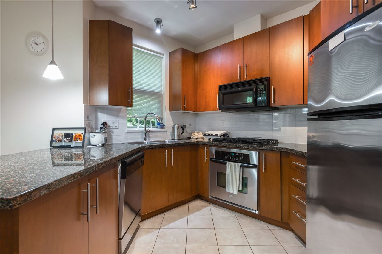 "Main Photo: 107 3551 FOSTER Avenue in Vancouver: Collingwood VE Condo for sale in ""FINALE WEST"" (Vancouver East)  : MLS®# R2499336"