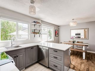 Photo 9: 63 Amiens Crescent in Calgary: Garrison Woods Semi Detached for sale : MLS®# A1098899