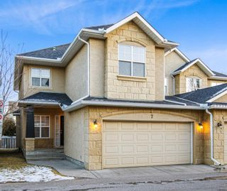 Photo 1: 7 39 Strathlea Common SW in Calgary: Strathcona Park Semi Detached for sale : MLS®# A1056254