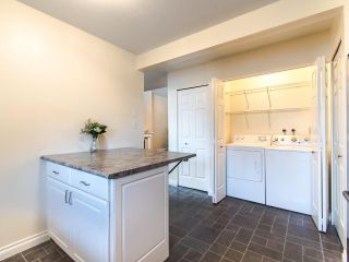 Photo 7: 404 2733 ATLIN PLACE in Coquitlam: Coquitlam East Condo for sale : MLS®# R2419896