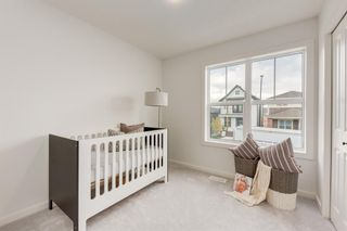 Photo 33: 249 Lucas Avenue NW in Calgary: Livingston Row/Townhouse for sale : MLS®# A1102463