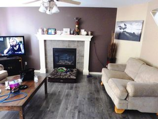 Photo 3: 907 WESTMOUNT Drive: Strathmore Semi Detached for sale : MLS®# A1119443
