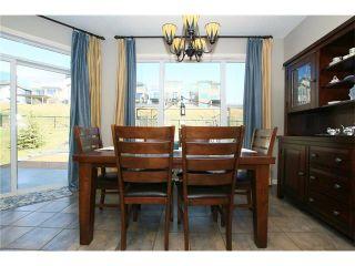 Photo 11: 188 SUNSET Close: Cochrane House for sale : MLS®# C4115906