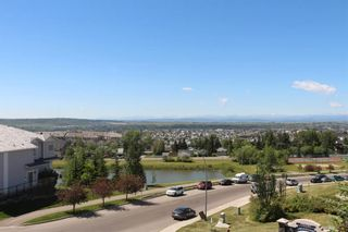 Photo 2: 219 Rocky Vista Circle NW in Calgary: Rocky Ridge Row/Townhouse for sale : MLS®# A1074376