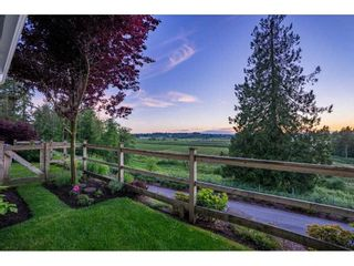 """Photo 1: 209 16380 64 Avenue in Surrey: Cloverdale BC Condo for sale in """"The Ridge at Bose Farms"""" (Cloverdale)  : MLS®# R2589170"""