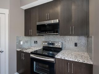 Photo 12: 490 Rainbow Falls Drive: Chestermere Row/Townhouse for sale : MLS®# A1115076