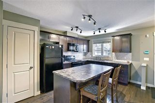 Photo 10: 161 Rainbow Falls Manor: Chestermere Row/Townhouse for sale : MLS®# A1083984