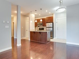 """Photo 5: 316 10237 133 Street in Surrey: Whalley Condo for sale in """"ETHICAL GARDENS"""" (North Surrey)  : MLS®# R2322392"""